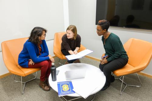 Three women meeting in a room in the new Center