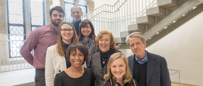 Faculty Members and Digital Education Staff members stand on the staircase in the CTL