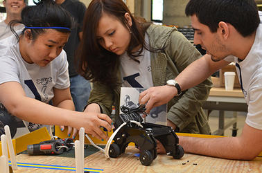 Three students work on an Engineering Project, two female and one male