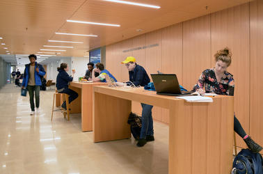 A group of students works at the touchdown desks in the Learning Commons at the CTL.