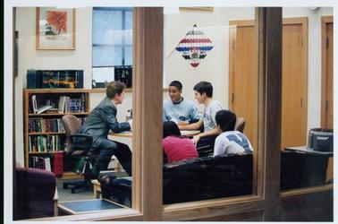 Instructor and students in seminar room