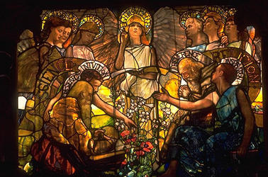 A stained glass window from Linsly-Chitenden Hall designed by Tiffany and Co, this window depicts science and religion in harmony