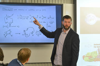 Professor Newhouse uses digital screens in the TEAL classroom to enhance his class