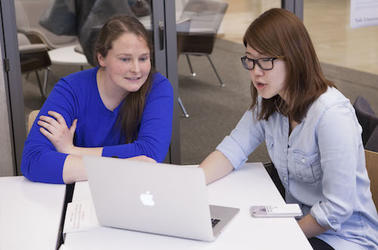 Two women work on a table in a classroom at Yale's CTL