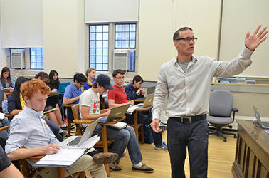 James Rolf teaches a class of students at Yale
