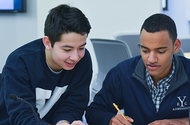Two students discuss an assignment in class at Yale