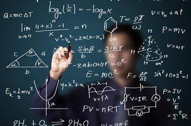 Teacher writing equations on a whiteboard