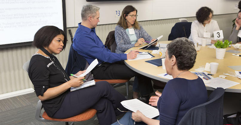 Tracie Addy and a Faculty Member Discuss Teaching at a round table with other faculty members present