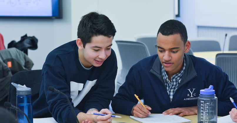 Two students discuss an assignment in the TEAL classroom